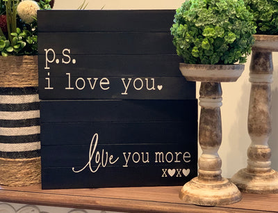 P.S. i love you / love you more (February Sign of the Month) shows an image of the two signs displayed together with topiaries and candlesticks.  Each sign sold separately unless purchased together.