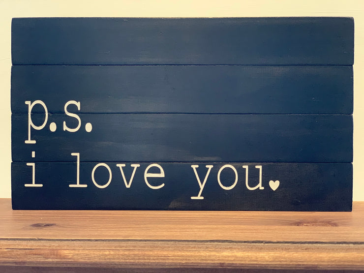 P.S. i love you sign is displayed sitting on a shelf.  This black pallet board has white hand painted lettering.