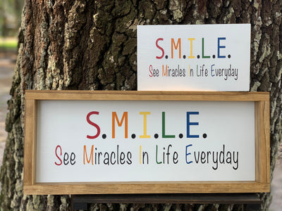 S.M.I.L.E. / See Miracles In Life Everyday, this sign is displayed with the small wood block sign.  Each sign is sold separately.