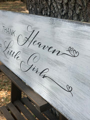 Thank Heaven For Little Girls (Distressed Wood Sign) shows an angled close up image of the hand painted words.