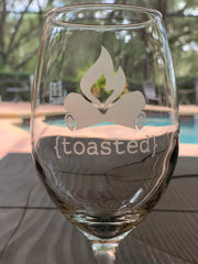 This image shows a close up of the toasted etched wine glass.