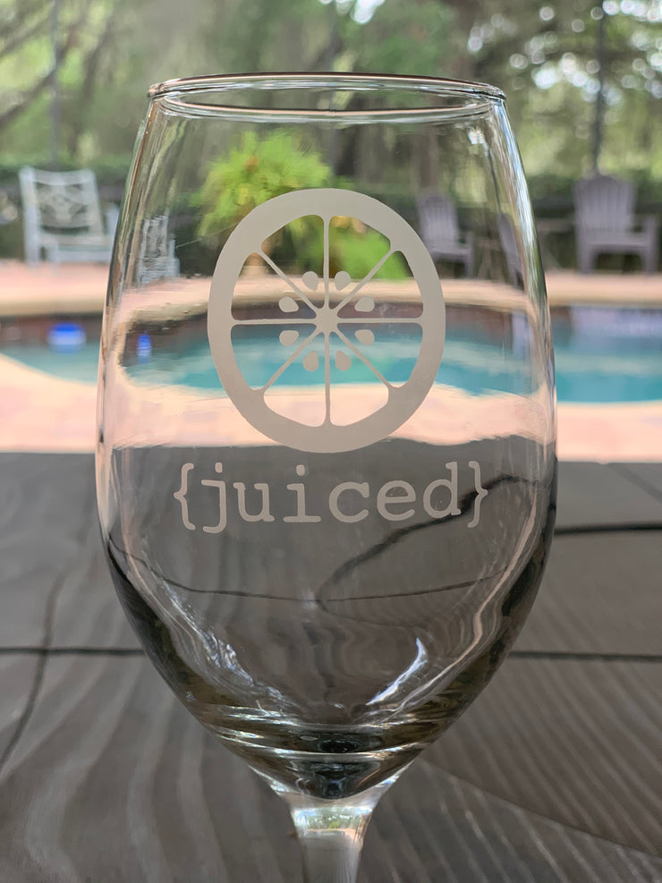 This image shows a close up of the juiced etched wine glass.