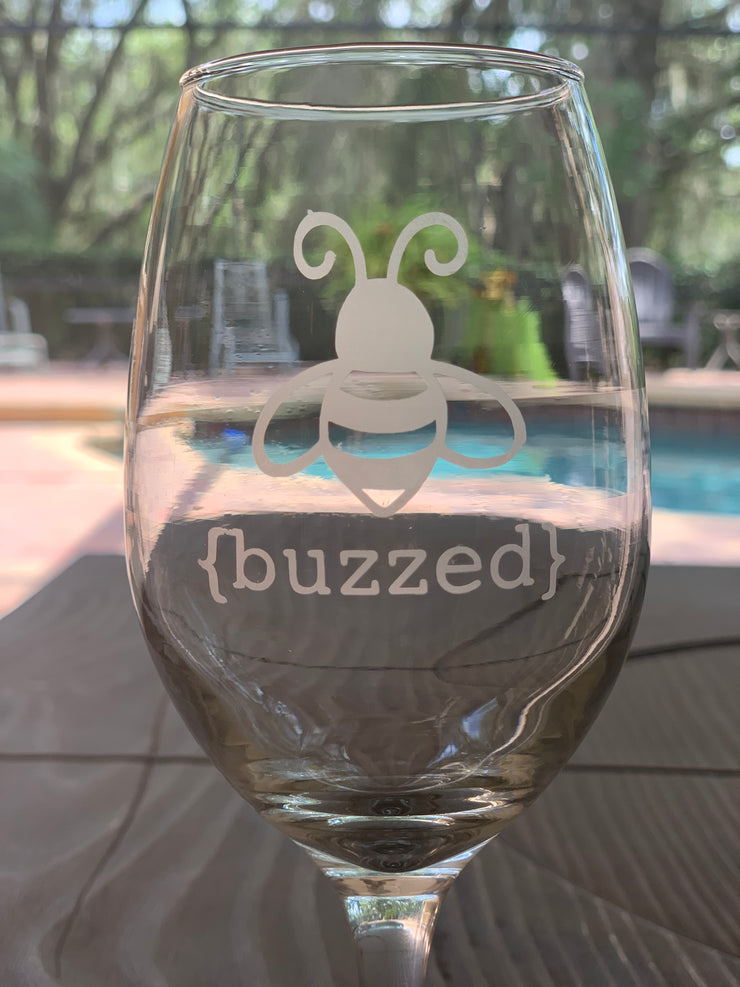 This image shows a close up of the buzzed etched wine glass.
