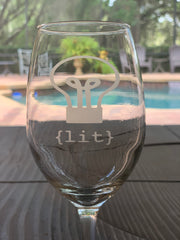 This image shows a close up of the lit etched wine glass.