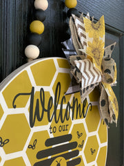 Welcome To Our Hive Beaded Garland Door or Wall Hanger shows a close up view of the board, bow and ribbon.