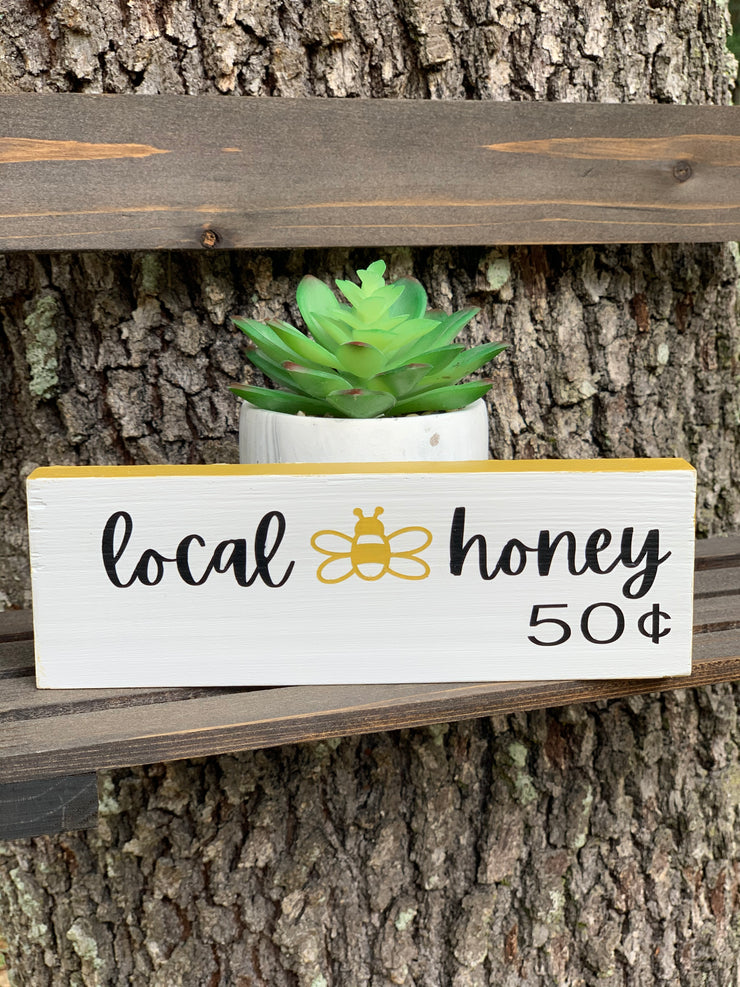 Local Honey 50 Cents is shown displayed with a succulent.  Perfect for all small spaces.