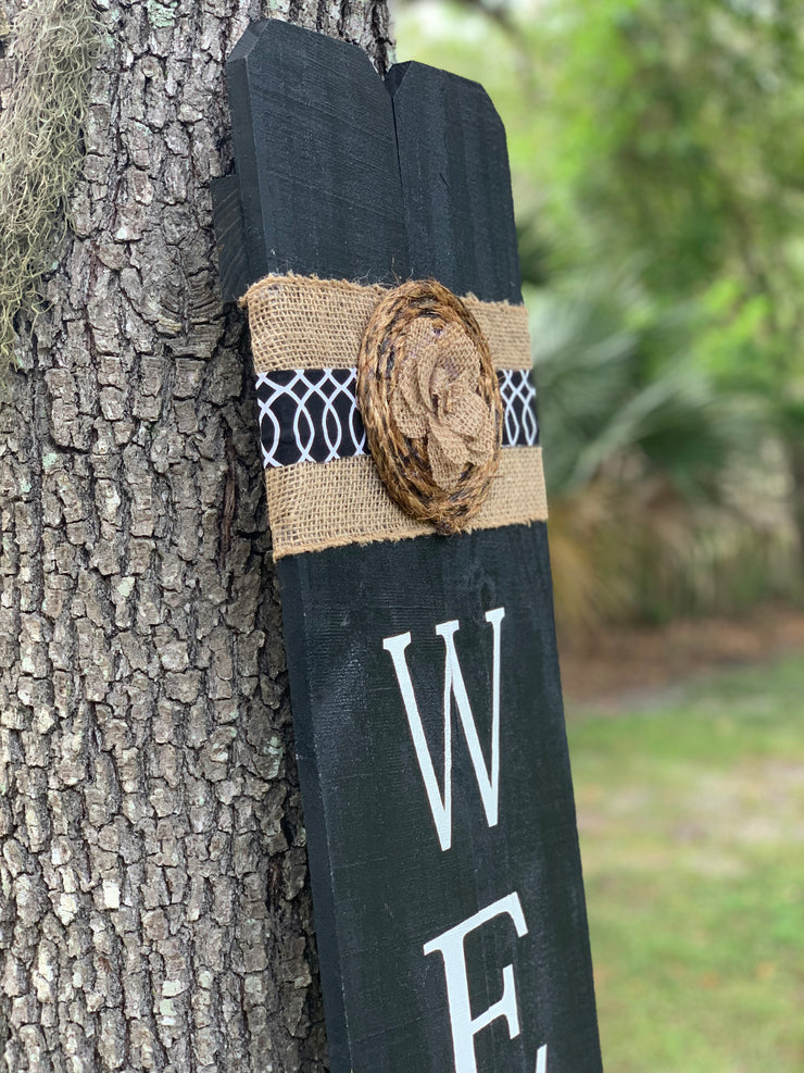 This image displays a close up visual of the burlap wrap and twine used to decorate the top of the sign.