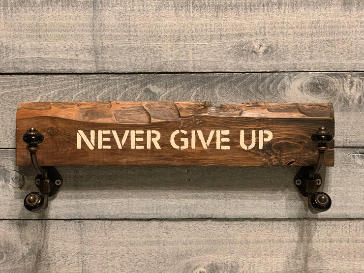 Never Give Up farmhouse sign is made from reclaimed wood