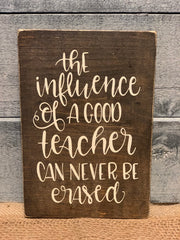 The Influence of a good teacher can never be erased wood block sign