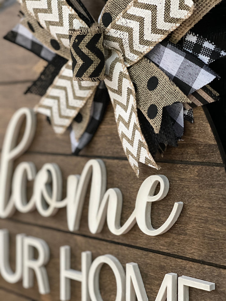 This image shows a close up of the 3D white wood cutout and burlap bow.
