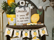 This image shows the white lemon banner hanging on our cathedral tiered tray.  It also has multiple lemon decor which is each sold separately.