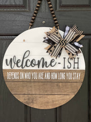 "Welcome-ish Shiplap Door Hanger shows the 18"" round on a front door."