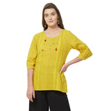 Yellow tunic with lace insert and embroidery