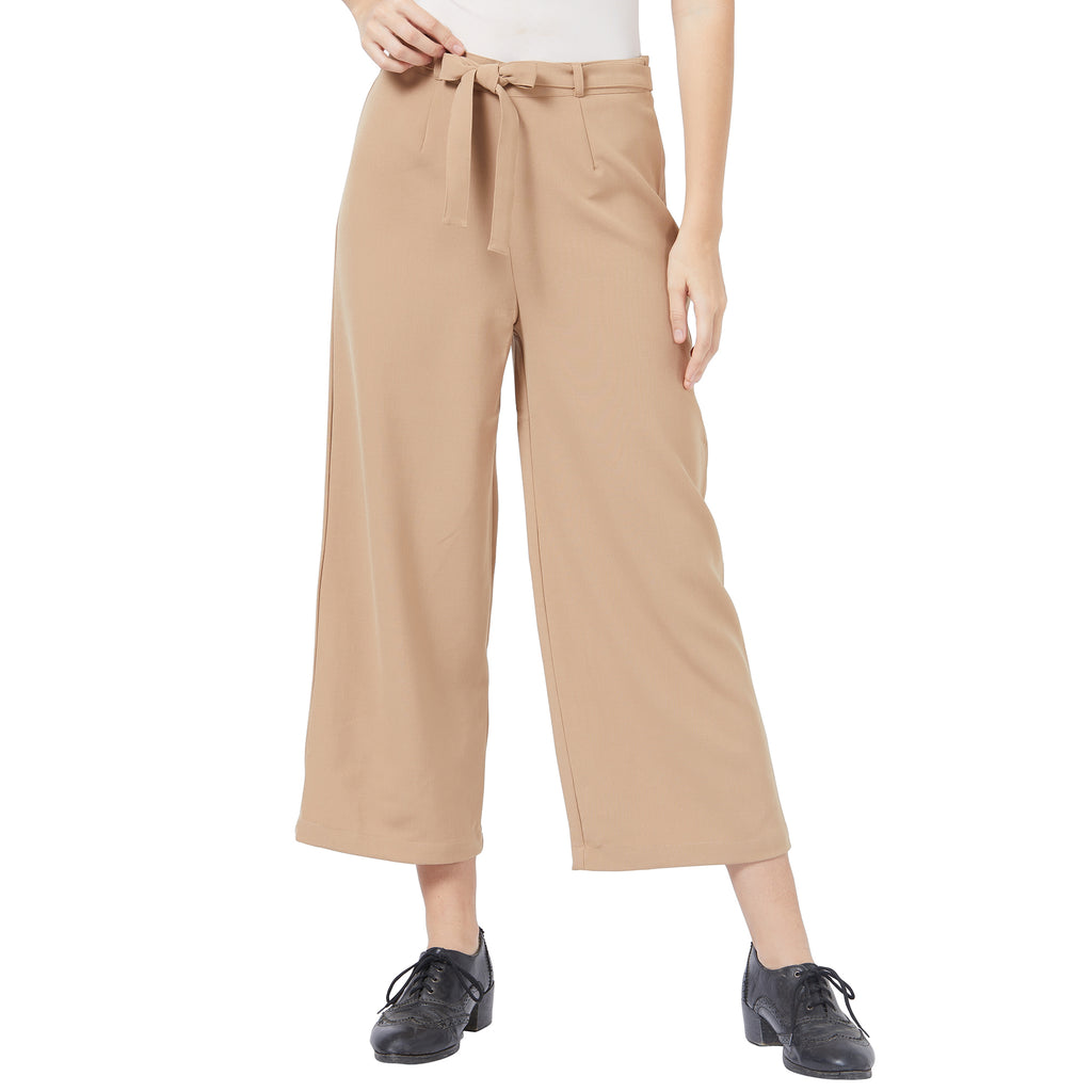 Relaxed trousers with self belt