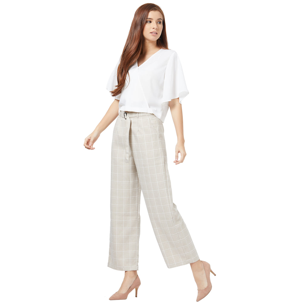 Wide legged trousers with self belt