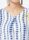Printed top with embroidered emblem