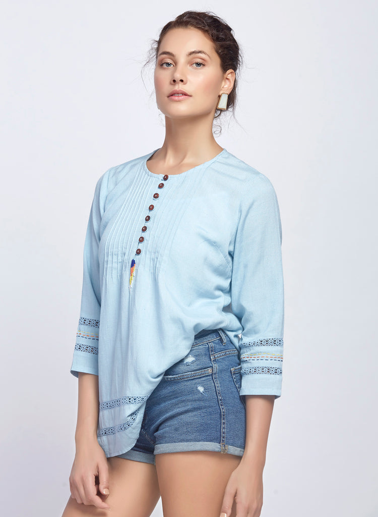 A-line top with contrast hand embroidery and beaded tassel