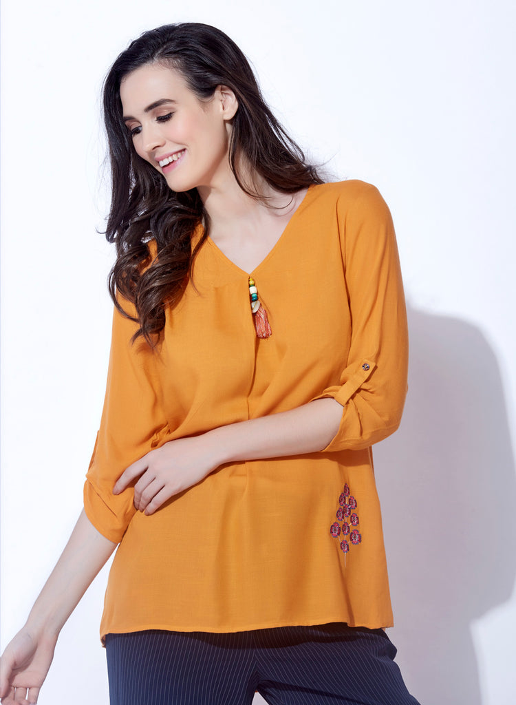 Rayon slub solid top with embroidery