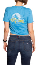 Load image into Gallery viewer, Ladies Corona Beach Side Crop Top- Heather Sapphire Back Side With Island Print Palm Trees and Corona Extra Logo