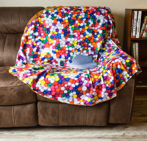Realistic Donut Blanket Draped Over Couch