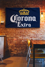 "Load image into Gallery viewer, Corona Indoor Wall Banner- Corona Crown (30"" by 50"") Banner Hanging on Brick Wall"