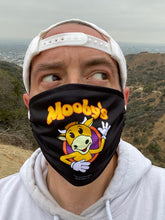 Load image into Gallery viewer, Mooby's Face Mask, Black Background, Modeled by Kevin Smith.