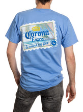 Load image into Gallery viewer, Corona Extra Beachside T-Shirt In Carolina Blue Back. Corona Stamp.
