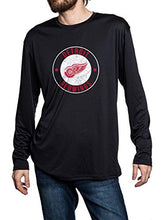 Load image into Gallery viewer, Detroit Red Wings loose fit long sleeve rashguard in black. Distressed logo in middle of the chest.