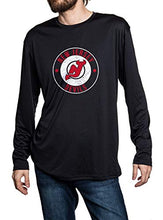 Load image into Gallery viewer, New Jersey Devils loose fit long sleeve rashguard in black, front view. Distressed logo in middle of the chest.