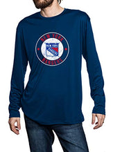 Load image into Gallery viewer, New York Rangers loose fit long sleeve rashguard in blue, front view. Distressed logo in middle of the chest.