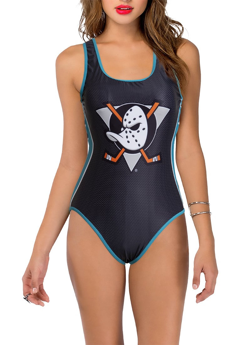 Anaheim Ducks One Piece Swimsuit for Women, Front View. Large Logo in Middle of Chest, on Navy  Mesh-Style Print. Light Blue Trim