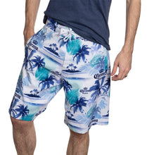 Load image into Gallery viewer, Men's Corona Boardshort- Palm Print Front View With Man Hand In Pocket Blue White And Green Print