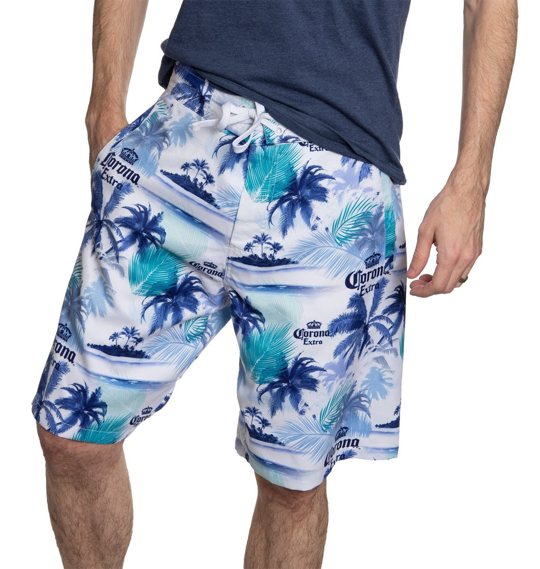 Men's Corona Boardshort- Palm Print Front View With Man Hand In Pocket Blue White And Green Print