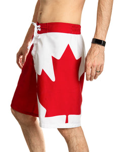 Red and White Canada Boardshort Swim Trunks. Side View. Maple Leaf Down Leg.