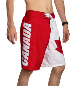 Red and White Canada Boardshort Swim Trunks. Side View., CANADA Written Down Leg.