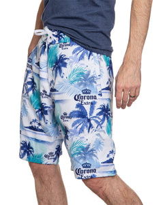 Men's Corona Boardshort- Palm Print Side View With Man Hand In Pocket Blue White And Green Print