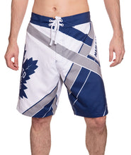 Load image into Gallery viewer, Men's Officially Licensed NHL Diagonal Boardshorts - Toronto Maple Leafs Full Front Photo OF Man Wearing Shorts