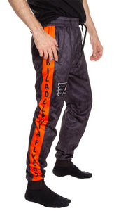 Philadelphia Flyers Tie Dye Jogger Pants for Men Side View. Orange Stripe With Philadelphia Flyers Down Leg.
