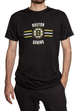 Load image into Gallery viewer, Men's Officially Licensed NHL Distressed Lines Short Sleeve Performance Rashguard Wicking T-Shirt- Boston Bruins Man Wearing T-Shirt With Hand In Pocket