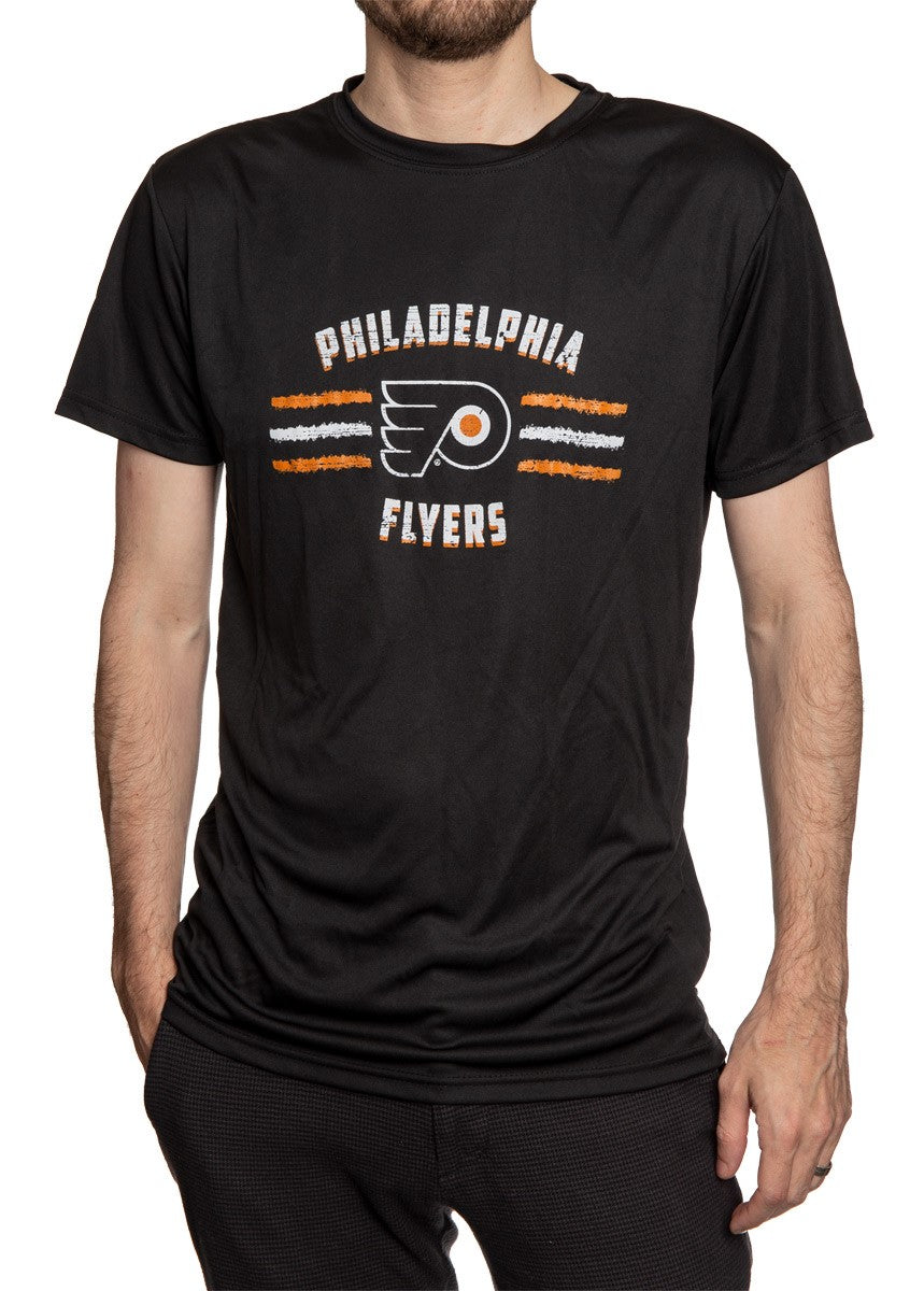 Men's Officially Licensed NHL Distressed Lines Short Sleeve Performance Rashguard Wicking T-Shirt- Philadelphia Flyers  Full Length Front View Of Man Wearing Shirt WIth Hand In Pocket
