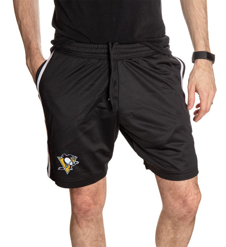 NHL Mens Official Team Two-Stripe Shorts- Pittsburgh Penguins Full Length Front View WIth Man Hand In Pocket