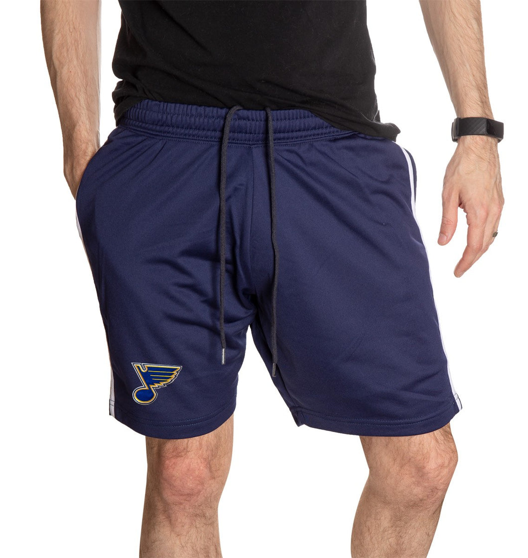 NHL Mens Official Team Two-Stripe Shorts- St. Louis Blues Full Length Front Photo Of Man Wearing Shorts WIth Hand In Pocket