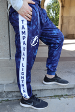 Load image into Gallery viewer, Tampa Bay Lightning Tie Dye Jogger Pants for Men Hand in Pocket.
