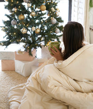 Load image into Gallery viewer, Wool Comforter wrapped around woman in front of holiday tree