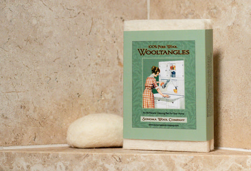 Sonoma Wool Company wool tangles in packaging, on display against beige tiling