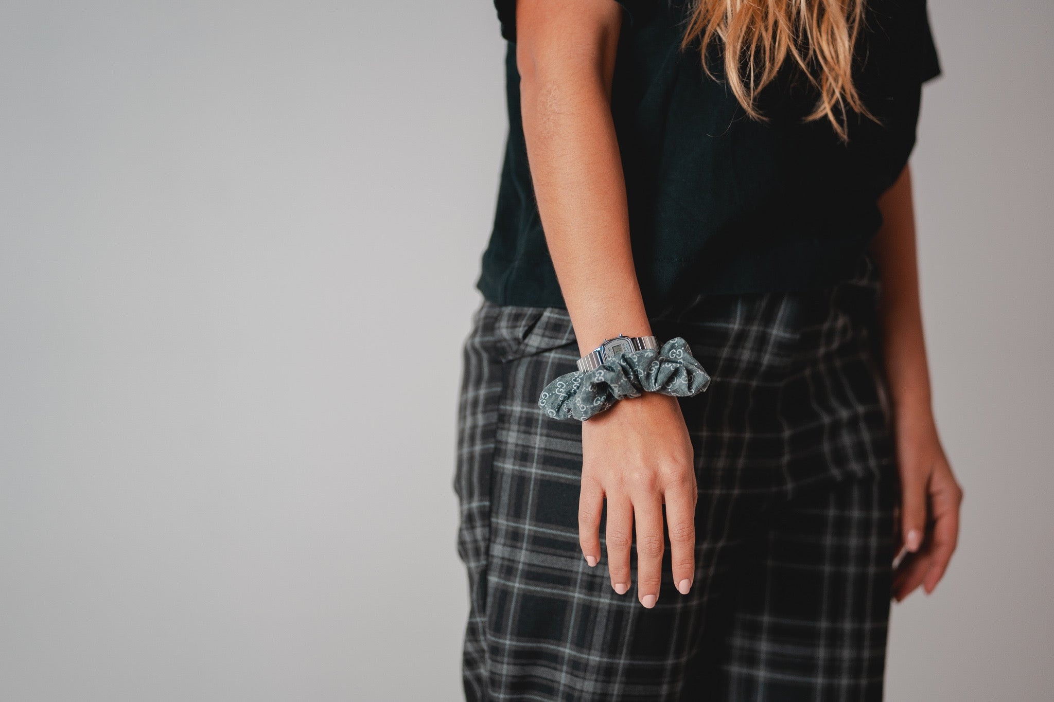 Young Girl Wearing Black Gucci Scrunchie On Wrist