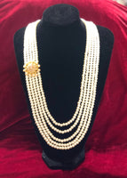 Groom's mala with polki brooch - Indian Wedding Bazar