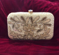 Designer clutch soft gold flower pattern - Indian Wedding Bazar