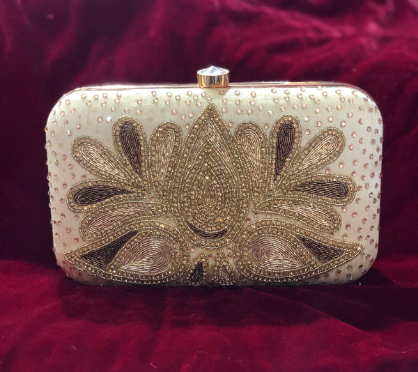 Designer clutch in soft gold with handwork