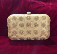 Clutch in gold with handwork - Indian Wedding Bazar